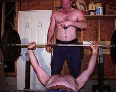 garage bench pressing guys workout