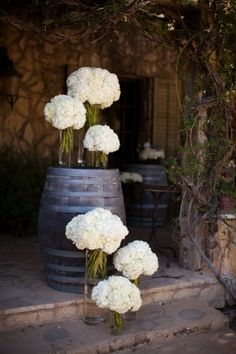 8. Nice rustic wine barrel decor very pretty and romantic when mixed with flowers