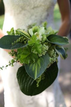 I love this monochromatic green wedding bouquet with shades of emerald, jade, spring green and a dark earthy green. This is perfect with the trim of our historic estate, and the beautiful woodland that surrounds the venue! Venue: Willowdale Estate - WillowdaleEstate.com Photography: Tilley Photography Read More: http://www.stylemepretty.com/2014/05/08/antique-and-chic-new-england-wedding-at-willowdale-estate/