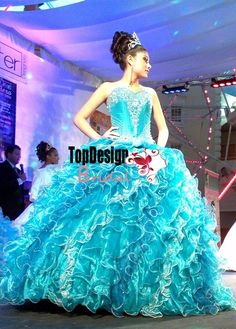 Wholesale 2016 new sweet 15 dress beading applique turquoise organza puffy quinceanera ball gown FN98