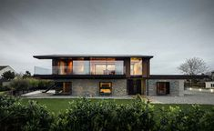 a striking contemporary home built on the Welsh coast to withstand the elements and make the most of views