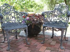 Antique cast iron chairs with floral pattern and claw foot