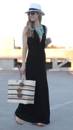 spring outfit idea: black deep cut maxi dress with Panama hat