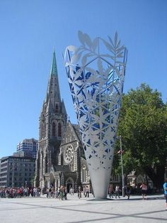The central square in Christchurch has a gothic style cathedral and a modern sculpture