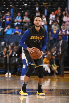 OAKLAND, CA - FEBRUARY 10: Stephen Curry #30 of the Golden State Warriors handles the ball before the game against the San Antonio Spurs on February 10, 2018 at Oracle Arena in Oakland, California. (Garrett Ellwood/NBAE via Getty Images)