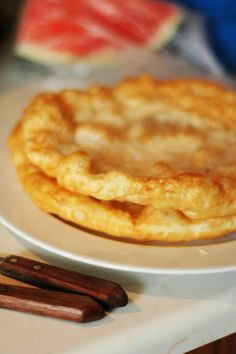Langoše - Pancake Puff path-average,served with salt, rubbed the garlic. On top of the scoring grated cheese and sour cream. Sometimes is usually served on the sweet.