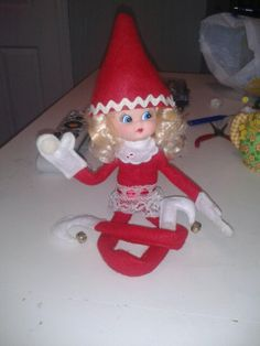 Morna Jingles, our elf on a table.