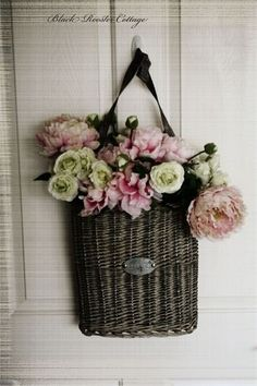 hang flattish baskets on doors, filled with either fresh, dried or silk flowers and greenery