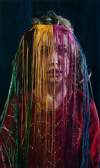 KATIE MILLER Girl Behind a Tinsel Veil 2014, oil on panel, 40 x 24 inches.