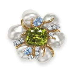 Lot 109 –  A PERIDOT, CULTURED PEARL AND DIAMOND BROOCH, BY SEAMAN SCHEPPS    Estimate:  $3,000 – $5,000