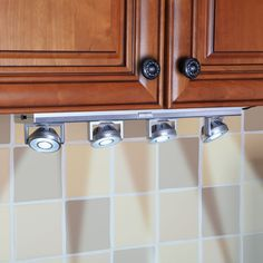 The Under Cabinet Pivoting Spotlights - Hammacher Schlemmer