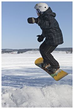 Youngsters having fun with their snow-boards in Kuopio, Finland. Photographer J-P Korpi-Vartiainen.