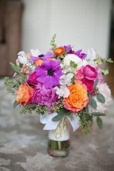 Bright Purple and Orange Bouquet | A Fun & Sophisticated DC Wedding via TheELD.com | Kristen Gardner Photography