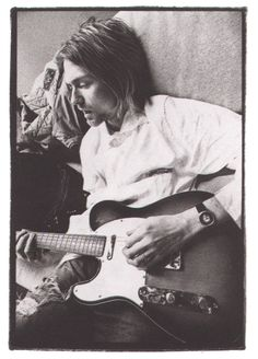 Kurt Cobain playing a Fender Telecaster