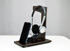 "A nice looking and usable combination of smartphone and headphones docking station.  The main construction is made from 5 mm (0.2"") laser cut acrylic. The genuine Italian leather is put on the acrylic and then hand stitched through it.  The result is heavy duty docking station which will serve you for many years. High quality hand made item with vintage outlook.  Order it now! My site: http://dorado.pro My Etsy shop: https://www.etsy.com/shop/DoradoPro?ref=hdr_shop_menu"