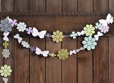 paper punches sewn together. Wouldn't this Garland be a snap with Cricut cut-outs?