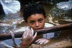 Omayra Sánchez was one of the 25,000 victims of the Nevado del Ruiz (Colombia) volcano which erupted on November 14, 1985. The 13-year old had been trapped in water and concrete for 3 days. She died days later and never had the chance to live any childhood dreams.