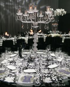 A crystal candelabra makes for one dramatic #centrepiece. See more on WedLuxe.com (: @mangostudios, planner: @aroraevents, floral & decor: @rldesignsinc, venue: @universaleventspace1982)