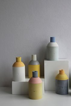 Series of hand-made concrete containers by designer Marta Bakowski, resulting from a research that explores the potential and poetics of color within a common construction material.