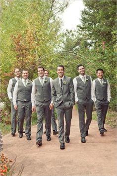 Grey Suit groomsmen not wearing jackets.
