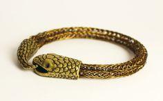 Brown snake bracelet, unisex Norse jewelry via An American Winkel. Click on the…
