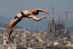 Sergy Nazin of Russia competes in the world diving championships as Barcelona's iconic Sagrada Família cathedral looms in the background on July 28.