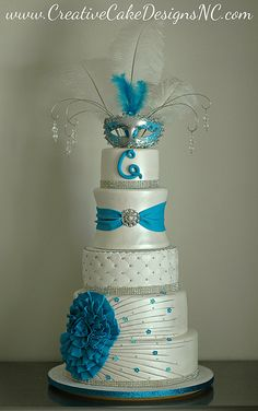Quinceanera Cake: LOVE IT BUT IF THE TOPPER WAS A TIARRA INSTEAD OF A MASK