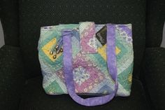 """Donna Sharp Katelyn Square Lori Tote-Quilted 13"""" double strap (7-row stitching!)  Back slip-pocket with Velcro closure  Top zippered closure with a flap-over snap  Expandable-snap side gussets  Interior full-width center zippered compartment  5 Interior slide-pockets  2 Interior zippered-pockets  2 Interior pen/pencil slip-pockets  Dimensions: 13 x 10 x 6"""" #donnasharp #handbags #giftsunder$50"""