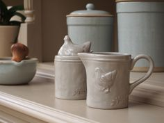This pretty country kitchen style sugar and creamer set has a lovely country kitchen charm with its soft warm grey colour and pretty hen design. The set includes a ceramic sugar bowl with a pretty hen shaped lid and sugar spoon, and a ceramic creamer jug. £12.50 from www.pastellane.co.uk. #sugarandcreamer #hens #chickens