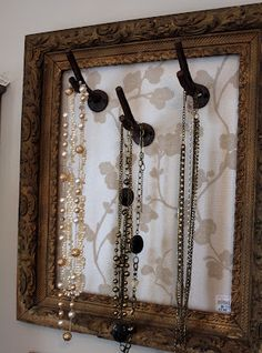 Vintage frames and twig wall hooks make a great jewelry organizer...(and many otheres ideas.......