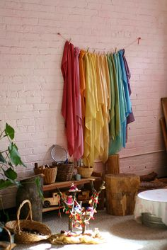 I could hang my scarves like this.... I like the brick wall. :) Hard to stick things to though I'd bet. lovely natural things. :)