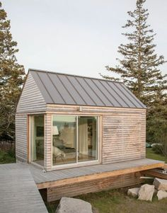 trio of tiny cabins forms a seasonal vacation retreat in an old quarry. One cabin is the living/dining/kitchen pavilion, the other two are sleeping cabins. Tiny Cabins, Tiny House Cabin, Tiny Guest House, Prefab Tiny Houses, Tiny Cabin Plans, Cob Houses, Lake Houses, Guest Houses, Log Cabins