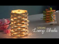 Learn how to make DIY Clothespin Lamp Shade. Take three medium sized wooden clothespin Remove the spring that holds the hands of the clips together . Wooden Clothespin Crafts, Clothespin Cross, Wooden Clothespins, Popsicle Stick Crafts, Craft Stick Crafts, Crafts For Seniors, Crafts For Kids, Home Crafts, Diy Crafts