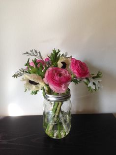 2hflowers a mix of ranunculus, anemones, and dusty miller in a small mason jar.
