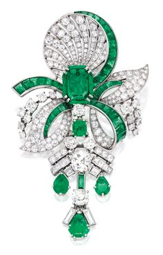PLATINUM, EMERALD AND DIAMOND PENDANT-BROOCH, signed Mauboussin, Paris, with French assay and workshop marks; circa 1935.