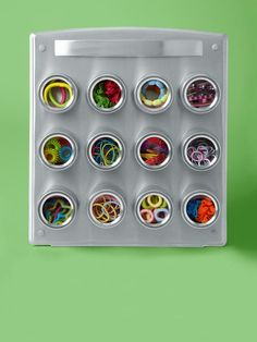 """""""This is a spice holder, but I use it to group the hundreds of hair accessories my daughters have amassed. It attaches to the wall, and the little magnetic containers are movable."""" — Betsy Goldberg, deputy editor, HGTV Magazine"""