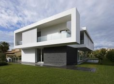 """Residential Architecture: Villa PM by Architrend Architecture: """"..The research project its own identity through the creation of simple volumes and divided between them. The contrast between the large windows and dark surfaces of the ground floor, lava stone, and the white walls of the first floor makes the construction to be suspended and light. At the ground floor windows open onto the garden are opposed to the first floor cantilevered walls consist of sliding panels in vertical profiles of…"""