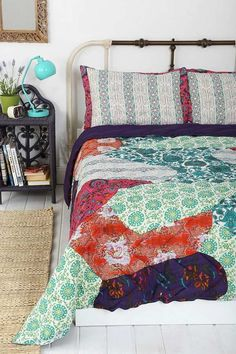 bedding pastel green grey red orange accents