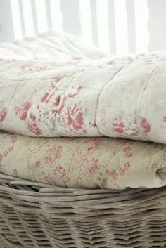Beautiful old and worn quilts.