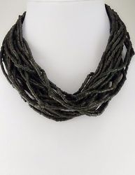 Multi strand bohemian/  puka style necklace