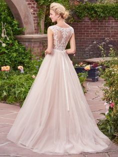 Charming and romantic, this tulle ballgown features lace appliqués that cascade over the bodice, illusion bateau neckline, and illusion back. Finished with covered buttons and zipper closure. Detachable beaded belt on grosgrain ribbon sold separately.
