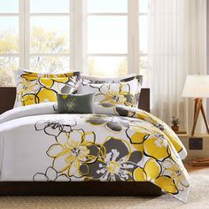 @Overstock - For a fresh look, this Mackenzie comforter set brightens up the room with vibrant yellow flowers. The comforter and sham reverse are dark grey for a great background, while dark grey and black accent colors outline the floral pattern.http://www.overstock.com/Bedding-Bath/MiZone-Mackenzie-4-piece-Comforter-Set/7910750/product.html?CID=214117 $59.99