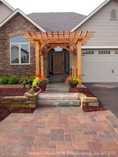 Custom Crafted Front Entrance Cedar Arbor with Borgert Strassen® Bavaria Tumbled Paver Patio - North Shore Color Blend by Switzer's Nursery & Landscaping, via Flickr