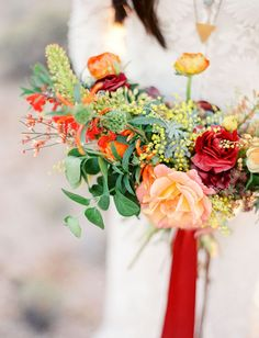 Desert boho bouquet with pink red + yellow tones