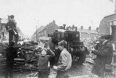 Three children and a journalist look on as a British soldier stands on top of a barricade prior to its dismantlement during Operation Motorman. Glass litters the ground and a cloud of CS gas hangs in the air. British Soldier, British Army, Belfast Northern Ireland, A Level Art, Ares, Arsenal Fc, Dublin, World War, Ireland