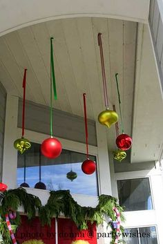 Hang Christmas bulbs from front porch