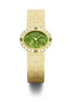 """Oval traditional watch in 18K yellow gold set with 20 brilliant-cut diamonds, 4 brilliant-cut emeralds  and natural jade dial. """"Palace"""" decoration gold bracelet. Piaget 56P quartz movement."""