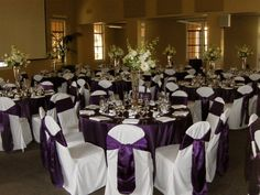 NTC Promenade white chair covers with purple eggplant satin sash