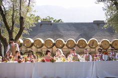 great wine barrel backdrop for their head's table