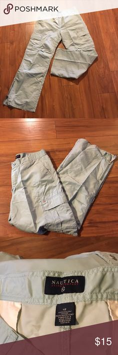 NWOT- Women's Wide-Leg Cargo Pants Light Blue Cargo Pants with side zip legs- NEVER BEEN WORN- THEY WERE PURCHASED WITH THE THREAD COMING APART-NOT SURE IF THEY CAN BE STITCHED BUT A CUTE LONG SHIRT MAY HIDE THE FLAW-please look carefully at the last 3 pictures Nautica Pants Wide Leg